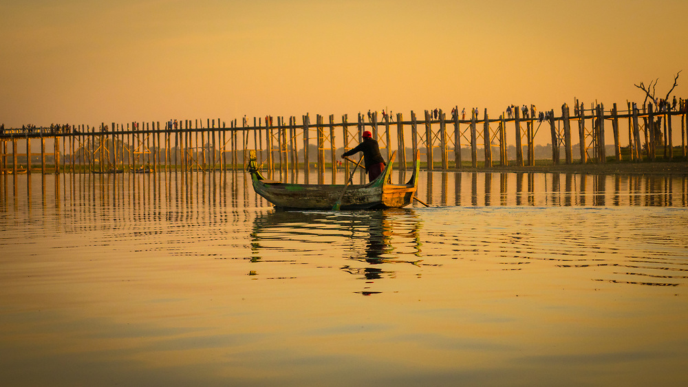 U Bein Bridge is a crossing that spans the Taungthaman Lake near Amarapura in Myanmar. The 1.2-kilometre bridge was built around 1850 and is believed to be the oldest and (once) longest teakwood bridge in the world