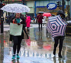 Women with umbrellas make their way across Piccadilly Circus. As forecasters predicted, the rain arrives in London where Londoners and tourists go about their business. London, February 13 2018.