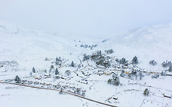 Aerial view of Wanlockhead village  covered in winter snow, Dumfries and Galloway, Scotland, UK