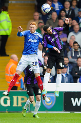 Ryan Taylor (ENG) of Portsmouth and Danny Woodards (ENG) of Bristol Rovers compete in the air - Photo mandatory by-line: Rogan Thomson/JMP - 07966 386802 - 19/04/2014 - SPORT - FOOTBALL - Fratton Park, Portsmouth - Portsmouth FC v Bristol Rovers - Sky Bet Football League 2.