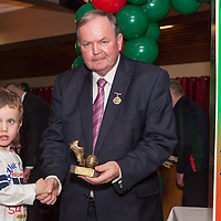 An tUachtaran Cumann Luthchleas Gael, Mr. Liam O'Neill, presents an award to Sean Hickey on behalf of his Dad Shane Hickey, during the launch of the book at the Kilmurry Ibrickane GAA Club Centenary Closing Ceremony