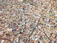 Aerial view of geometrical residential buildings and houses in Lima, Peru.