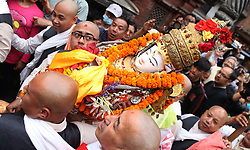 April 4, 2017 - Kathmandu, Nepal - Priests carry the idol of Seto Machhendranath towards chariot from the temple  during the celebration of Seto Machhendranath Chariot festival on the first day in Kathmandu, Nepal. HIndus and Boudhist both worship Seto Machhendranath as God of rain and prosperity. (Credit Image: © Archana Shrestha/Pacific Press via ZUMA Wire)