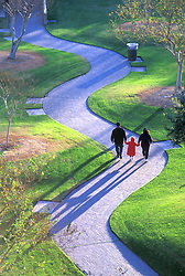 Stock photo of a family walking down a park path