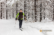 Cross country skiing at Round Meadows in the Flathead National Forest, Montana USA model released