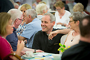 Father Dominic chatting to the Laity at the Diocesan Mid Summer Evening  set up by Bishop Noel Treanor. The Diocese of Down & Connor, Belfast, Northern Ireland.