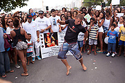 Young Brazilian male dancing Passinho at a protest in Copacabana, Rio de Janiero, in response to the mysterious death of professional dancer Douglas Rafael da Silva Pereira, allegedly at the hands of the Police. The favela Pavao-Pavaozinho that sits in between Copacabana and Ipanema. These protests saw a rare solidarity between the mostly middle class black bloc movement and members of the favela community.