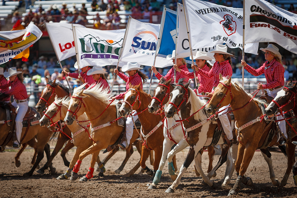 The Dandies Riding Group performs during Cheyenne Frontier Days, the world's largest outdoor rodeo.