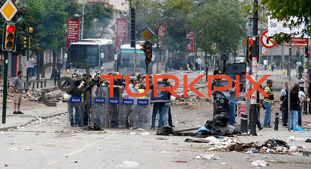 Turkish riot police use tear gas to disperse activists from the Gezi Park in Istanbul, Turkey, late 16 June 2013. Turkish riot police are firing water cannons and tear gas at protesters in Istanbul's Gezi Park, witnesses said on Saturday, hours after Prime Minister Recep Tayyip Erdogan vowed to remove them from the disputed public space by force. Protesters had earlier vowed to continue occupying the park, despite having reached a deal with the government on plans to redevelop it. Photo by AYKUT AKICI/TURKPIX