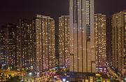 Massive Modern High Density High Rise Buildings at night with lights sparkling and views to the city