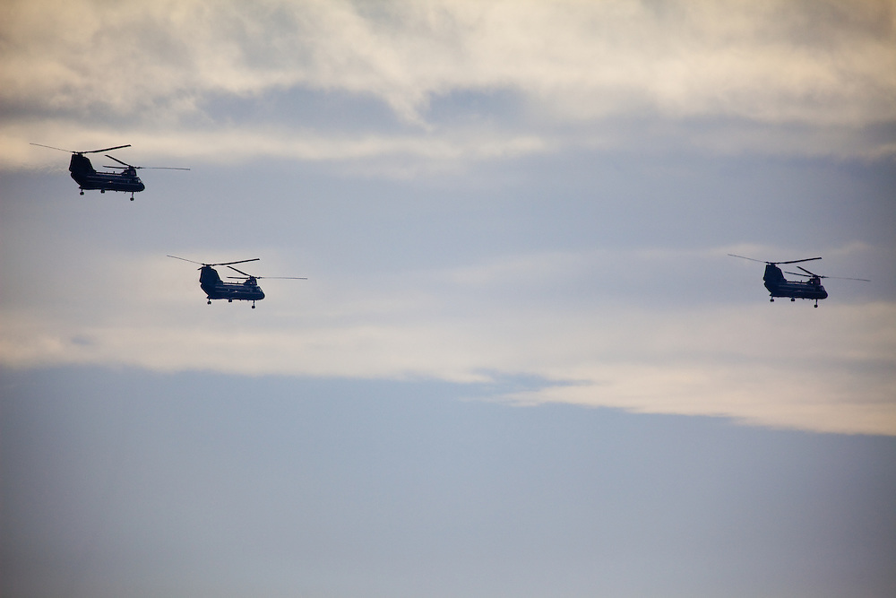 A trio of Boeing CH-47 Chinook Helicopters passing over the eastern shoreline of New Jersey
