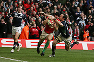 Leigh Halfpenny of Wales  brushes aside Graeme Morrison to score a try. RBS Six nations, Wales v Scotland at the Millennium stadium, Cardiff on Sat 13th Feb 2010. pic by  Andrew Orchard sports photography,