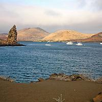 South America, Ecuador, Galapagos Islands, Bartholomew Island. Pinnacle Rock and bay of bartholomew Island.