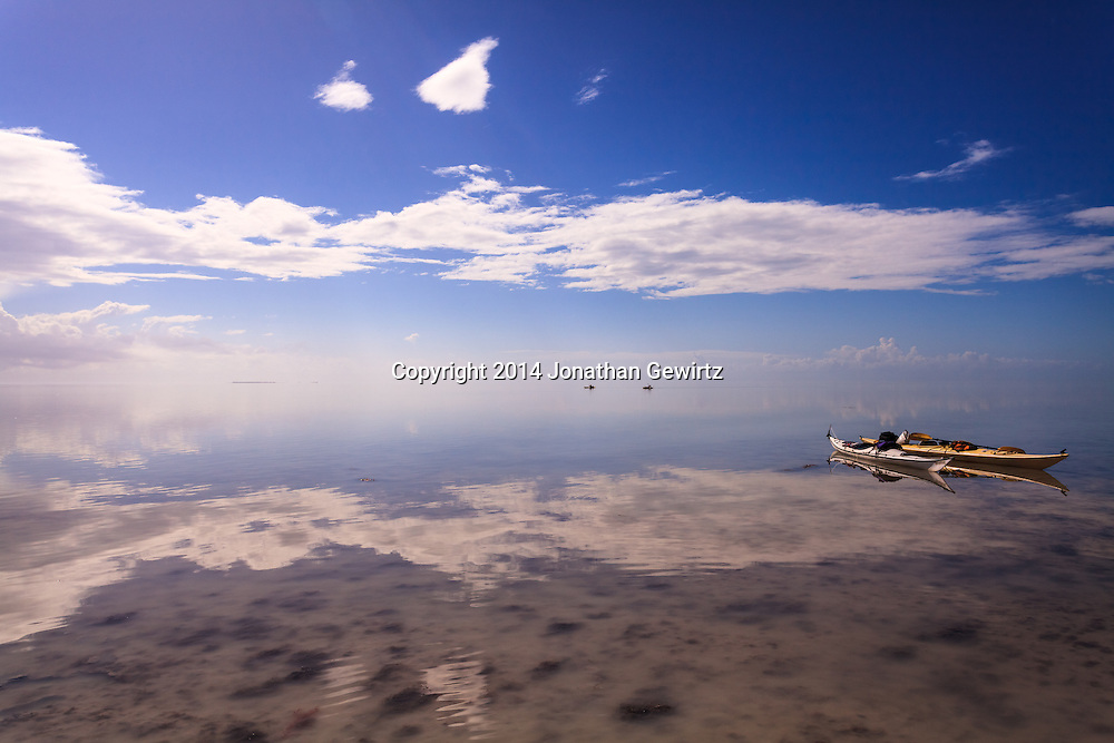 Kayakers enjoy the warm, shallow waters of Florida Bay in the southernmost part of Everglades National Park.<br /> <br /> WATERMARKS WILL NOT APPEAR ON PRINTS OR LICENSED IMAGES.<br /> <br /> Licensing: https://tandemstock.com/assets/92060193
