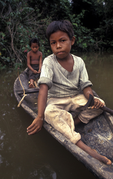 Brothers fishing in their canoe, near Leticia, Colombian Amazon