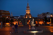 A man and a woman walk near the clock tower in Cartagena, Colombia at dawn. Prostitutes can be found openly soliciting clients all night in the plaza surrounding the clock tower, which is a zone where it is legal. A sex scandal erupted recently when secret service agents were found bringing prostitutes to their hotel rooms while in Cartagena preparing for President Barack Obama's arrival to the Summit of the Americas.