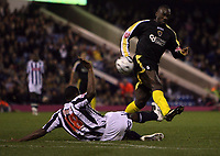 Photo: Rich Eaton.<br /> <br /> West Bromwich Albion v Cardiff City. Carling Cup. 25/09/2007. West Brom's Shelton Martis (L) tackles Jimmy Flloyd Hasselbaink (R).