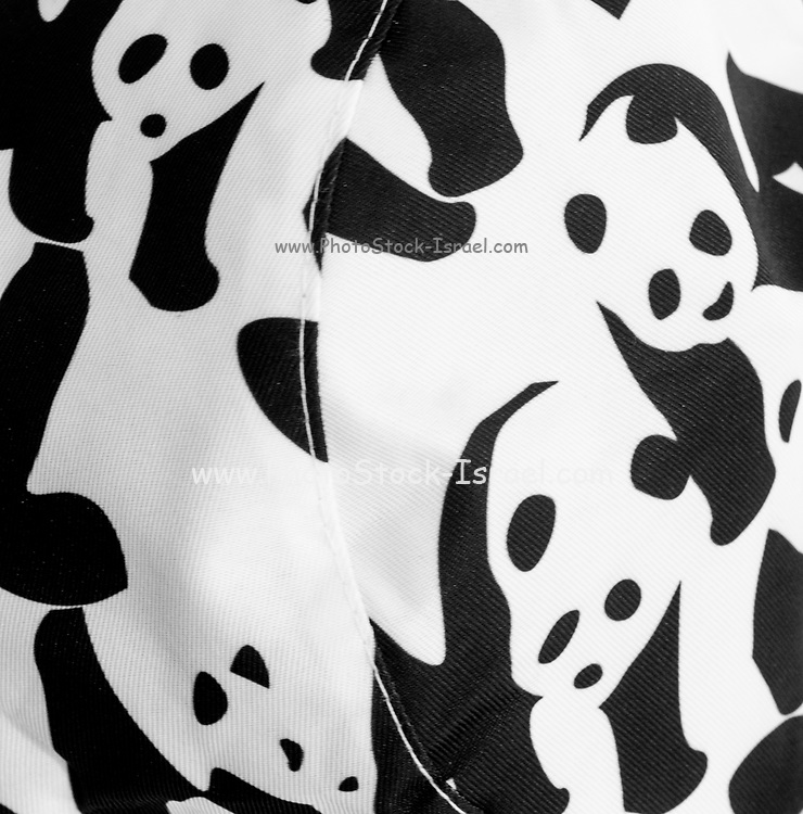 Abstract repeating panda design in black and white on fabric