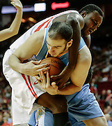 April 16, 2012; Houston, TX, USA; Houston Rockets center Samuel Dalembert (21) and Denver Nuggets center Kosta Koufos (41) reach for a rebound during the first quarter at the Toyota Center. The Nuggets won 105-102. Mandatory Credit: Thomas Campbell-US PRESSWIRE