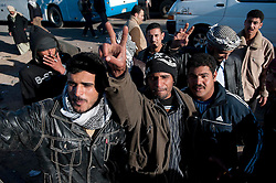 © under license to London News Pictures. 23/02/2011. Refugees who fled Libya for Egypt jump in excitement on the Egyptian side of the border. Photo credit should read Michael Graae/London News Pictures