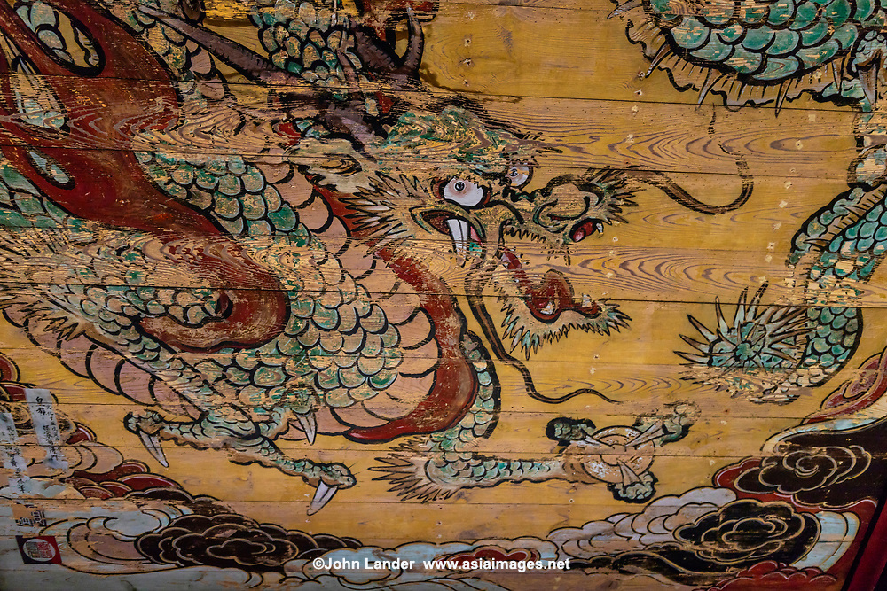 Kigami Shrine Dragon Fresco - Kigami Shrine, where you can see an elaborate ceiling painting of a dragon.  There is a square platform in the middle of the shrinie, where visitors can make a ringing noise by clapping their hands when offering a prayer.  Though the ceiling fresco of the dragon is somewhat faded, it is still worth a visit.  Dragons in temples and shrines are often used in decorations thought to ward off fire and evil.