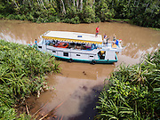 An aerial of a  klotok house boat on the Sekonyer River in Tanjung Puting National Park, Central Kalimantan, Borneo, Indonesia