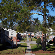 COLUMBIA, SOUTH CAROLINA - JANUARY 27: A man walks between buildings in Gable Oaks Apartments in North Columbia, SC on January 27, 2020.  A week earlier, a man was shot and killed at the apartment complex. The murder remains under investigation but Columbia police were able to apprehend 2 suspects.  (Photo by Logan CyrusforThe Washington Post)