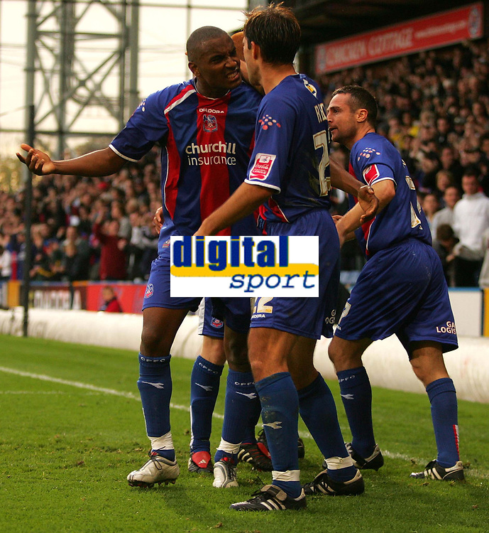 Photo: Frances Leader.<br />Crystal Palace v Sheffield Utd. Coca Cola Championship.<br />05/11/2005.<br />Crystal Palace's Michael Hughes (right) celebrates his gaol with team mates and Marco Reich