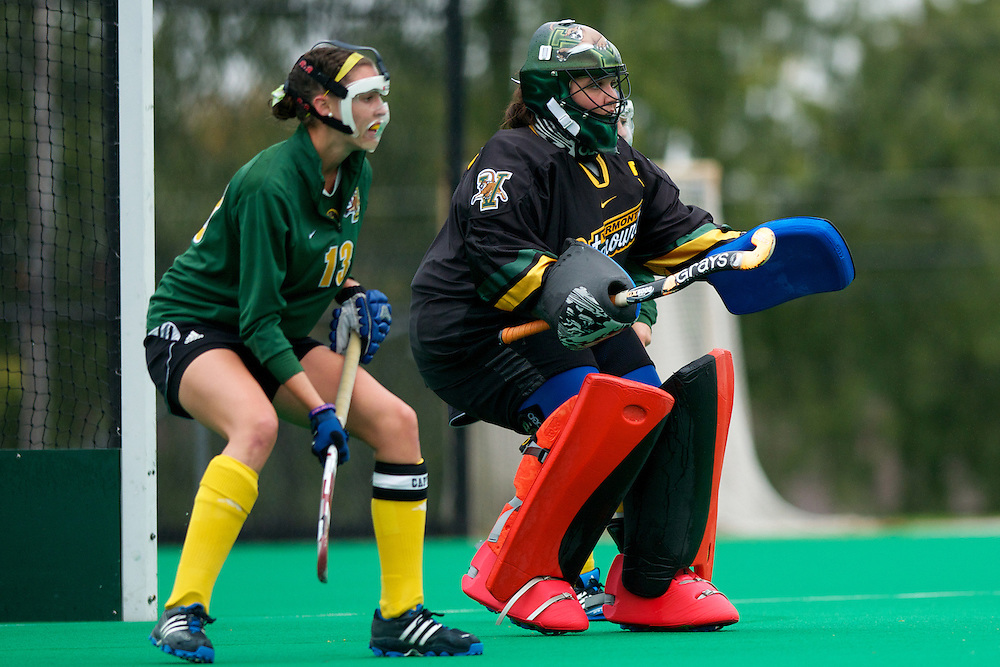Catamounts goalie Stephanie Zygmunt (5) and Catamounts midfielder Alana Izzo (13) keep an eye on the ball during the women's field hockey game between the Maine Black Bears and the Vermont Catamounts at Moulton/Winder Field on Saturday afternoon September 29, 2012 in Burlington, Vermont.