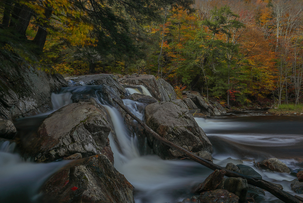 Scenic New England landscape photography of Buttermilk Falls in Ludlow, Vermont is available as museum quality photography prints, canvas prints, acrylic prints or metal prints. Prints may be framed and matted to the individual liking and decorating needs at:<br /> <br /> https://juergen-roth.pixels.com/featured/buttermilk-falls-juergen-roth.html<br /> <br /> This New England waterfall photography features the beautiful lower Buttermilk Falls in Ludlow, VT during fall foliage season and peak colors. <br /> <br /> Good light and happy photo making!<br /> <br /> My best,<br /> <br /> Juergen<br /> Photo Prints & Licensing: http://www.rothgalleries.com<br /> Photo Blog: http://whereintheworldisjuergen.blogspot.com<br /> Instagram: https://www.instagram.com/rothgalleries<br /> Twitter: https://twitter.com/naturefineart<br /> Facebook: https://www.facebook.com/naturefineart