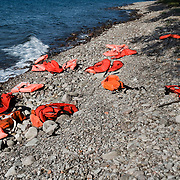 Discarded lifejackets on the on the beach near Skala Sykaminias in Lesbos island, Greece.Everyday hundreds of refugees, mainly from Syria and Afghanistan, are crossing in small overcrowded inflatable boats the 6 mile channel from the Turkish coast to the island of Lesbos in Greece. Many spend their life savings, over $1000, to buy a space on those boats.