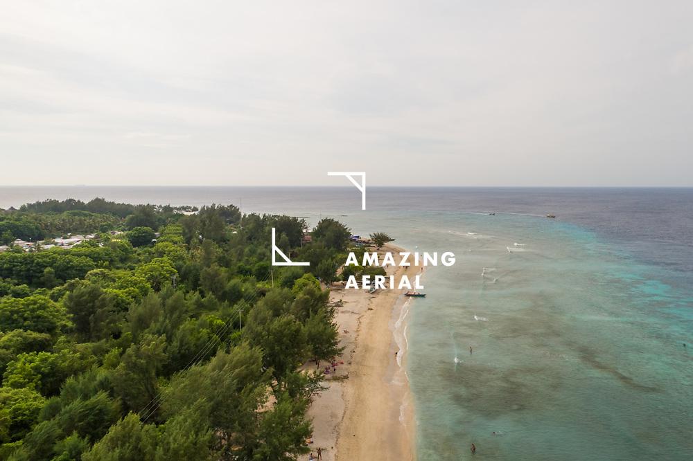 Aerial view of transparent coastal line on Lombok island, Indonesia.
