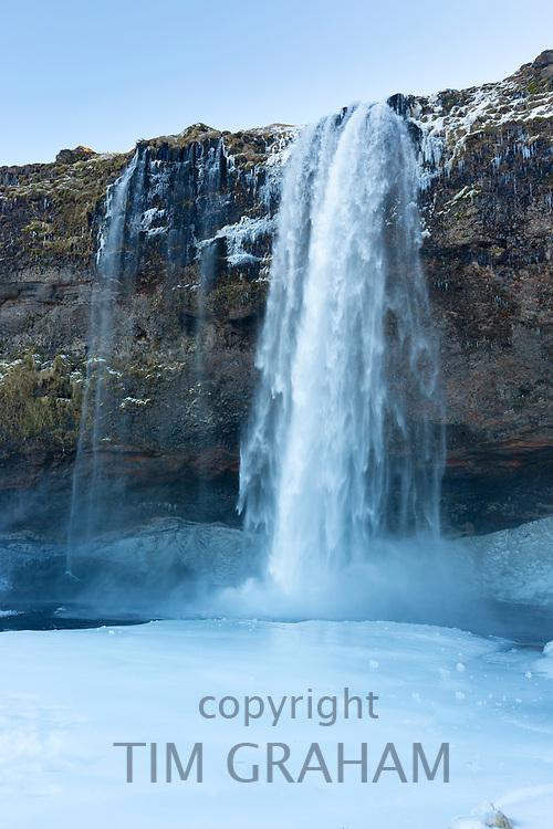 Spectacular waterfall Seljalandsfoss in South Iceland with gushing glacial melting waters from Eyjafjahajokul icecap