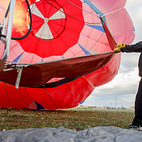 Jerome Haskie helps inflate a hot air balloon during the Zuni Fair Saturday in Zuni.