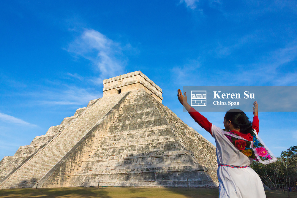 Tourist with Temple of Kukulkan (often called El Castillo), Chichen Itza, Yucatan, Mexico