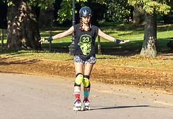 Licensed to London News Pictures. 16/09/2021. London, UK. A rollerblader enjoys the late summer sun in Hyde Park, London as weather forcasters predict a warmer few days ahead with highs of 24c for London and the South East. Photo credit: Alex Lentati/LNP