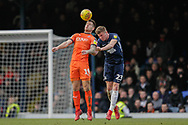 Luton Town forward James Collins (19) and Southend United defender Taylor Moore (23) battle for the ball in the air during the EFL Sky Bet League 1 match between Southend United and Luton Town at Roots Hall, Southend, England on 26 January 2019.