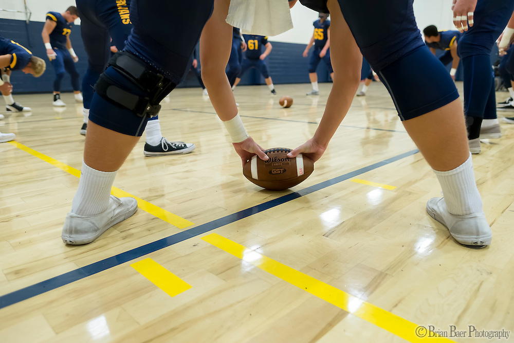 The Oak Ridge Trojans warm up inside the gym out of the rain before the game as the Oak Ridge High School Trojans host the Granite Bay Grizzlies, Friday Oct 14, 2016.<br /> photo by Brian Baer