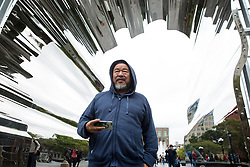 Chinese activist and artist, Ai Weiwei stands near his art project at Washington Square in New York,NY on October 12, 2017.   The artist assembeled 300 establishment around New York City statement  'Good Fences Make Good Neighbors'.  The works can be viewed through February 11, 2018. (Amir Levy/ SIPA USA)