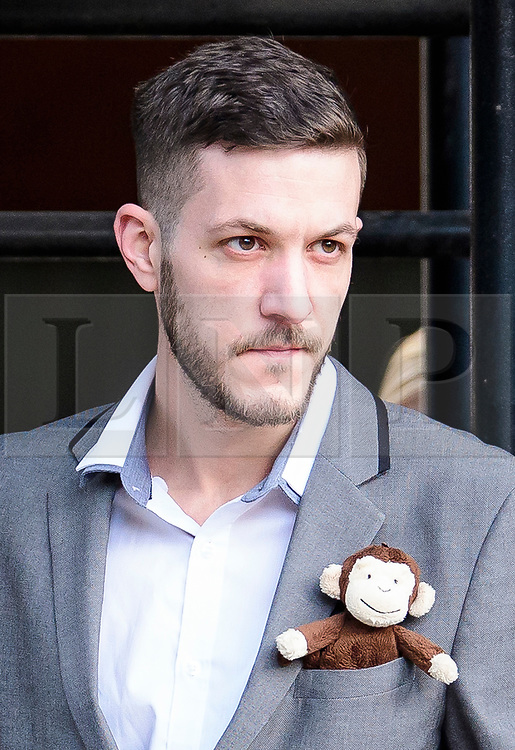 © Licensed to London News Pictures. 03/04/2017. London, UK. CHRIS GARD wearing a soft toy monkey in his top pocket as he leaves the The Royal Courts of Justice in London where a High Court judge is due to rule whether doctors can withdraw life-support treatment to their son, Charlie, who suffers from a rare genetic condition. Doctors at Great Ormond Street Hospital in London say eight-month-old Charlie should be left to die in dignity, but his parents have raised £1.2 million for specialist treatment in America.  Photo credit: Ben Cawthra/LNP