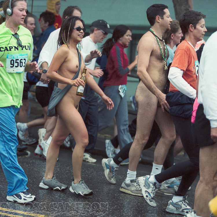 A naked couple seem to go unnoticed in the throng of joggers at the 91st running of the Bay to Breakers on Sunday, May 19, 2002 in San Francisco. (Photo by D. Ross Cameron)