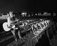 R. J. Cowdery, the winner of the 2012 Dave Carter Memorial Songwriting contest, waits before her appearance on the Village Green stage.