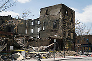 The charred and damaged remains of the Town Talk Diner building along Lake Street in Minneapolis, Minnesota on Monday, June 1, 2020. The multi-use building was damaged extensively during the civil unrest in the final days of May following the death of George Floyd at the hands of Minneapolis Police Department officers.