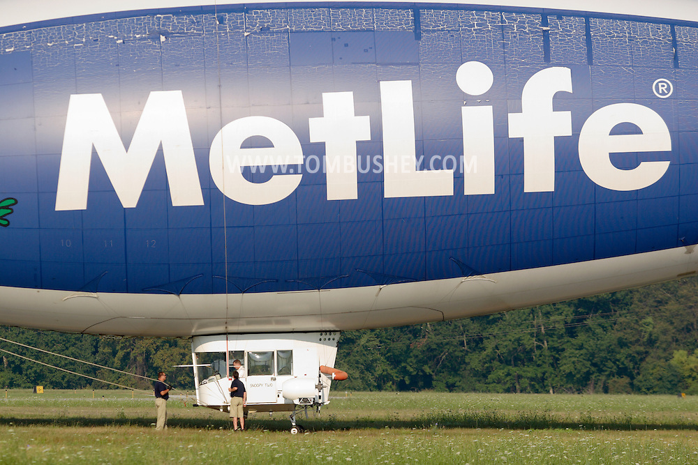 Montgomery, NY- The ground crew and pilot prepare the Met Life blimp Snoopy Two fortake off from Orange County Airport on July 26, 2008.