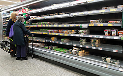 © Licensed to London News Pictures. 09/10/2021. London, UK. Shoppers looks at nearly empty shelves of pre-cooked meat products in Morrisons, north London amid fears of food shortages leading up to Christmas due to labour shortages following Brexit. According to figures from the Office of National Statistics, one in six people in the UK have been unable to buy essential foods in the past two weeks and the Army could be drafted in to drive HGVs over Christmas as the supply chain crisis continues. Photo credit: Dinendra Haria/LNP