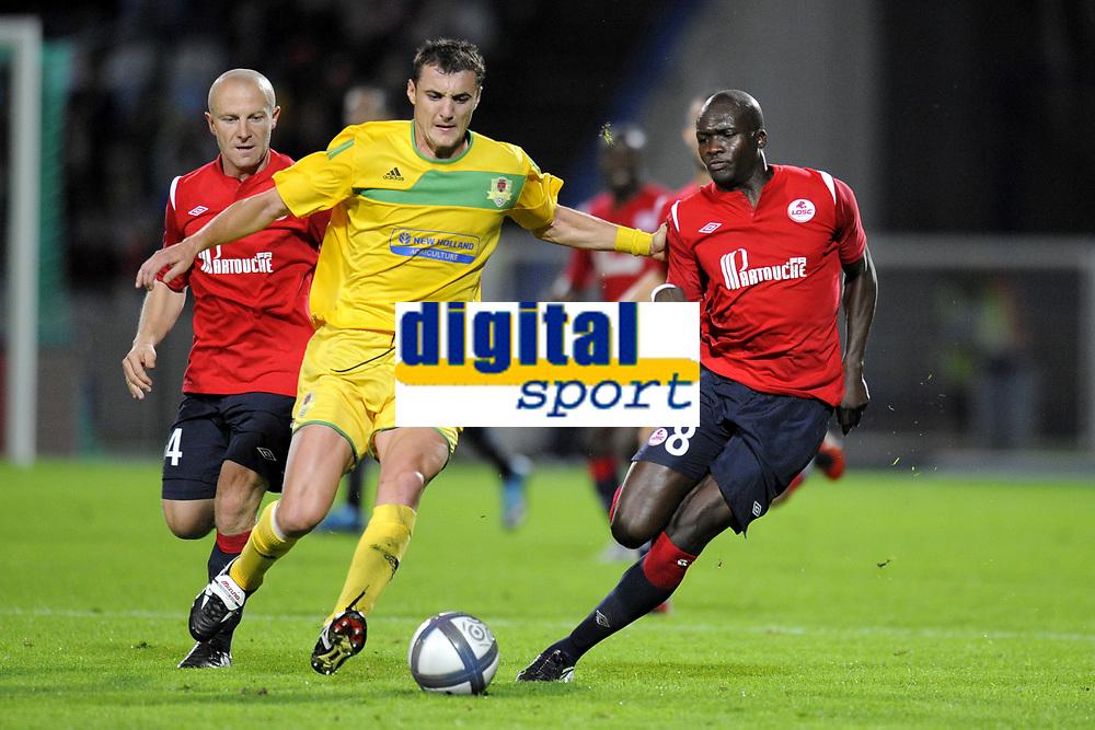 FOOTBALL - UEFA EUROPA LEAGUE 2010/2011 - PLAY OFF - 2ND LEG - LILLE OSC v FC VASLUI - 26/08/2010 - PHOTO JEAN MARIE HERVIO / DPPI - STANISLAV GENCHEV (FCV) / MOUSSA SOW (LOSC)