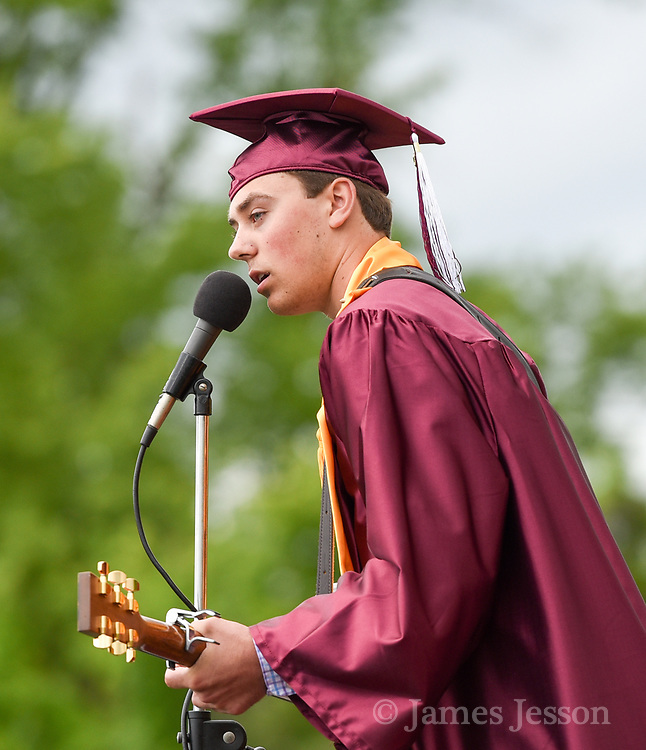 """Christopher Ruediger performs Tim McGraw's """"Humble and Kind"""" during the Concord Carlisle High School graduation exercise for the Class of 2017 in Concord, June 3, 2017.   [Wicked Local Photo/James Jesson]"""