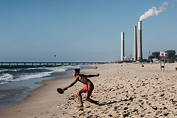 June 22, 2017 - Zikim, Israel - Israelis seek recreation at Zikim Beach, 3.5Km north of the Gaza Strip, adjacent to Israel Electric Company Rotenberg Station. The Palestinian Authority has requested Israel to reduce the amount of electricity it provides Hammas ruled Gaza, further unwilling to pay the amount it had paid for in the past. Israel had been supplying 125 megawatt hours to Gaza as the Strip's main source of power for over two months after Gaza's only power station ran out of fuel in April 2017, leaving the Hamas ruled territory with less than six hours of power a day. (Credit Image: © Nir Alon via ZUMA Wire)