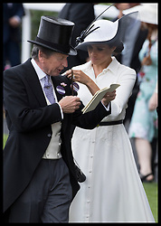 June 19, 2018 - Ascot, United Kingdom - Duchess of Sussex with The Queen's racing manager John Warren on the opening day of Royal Ascot, United Kingdom. (Credit Image: © Stephen Lock/i-Images via ZUMA Press)