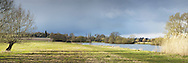 Winter storm clouds over the River Thames between Goring and Moulsford, Oxfordshire, Uk
